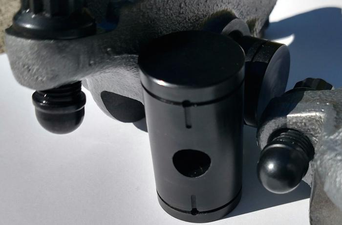 Common rail Cummins rocker arm trunnion and billet nitride adjusting screws.