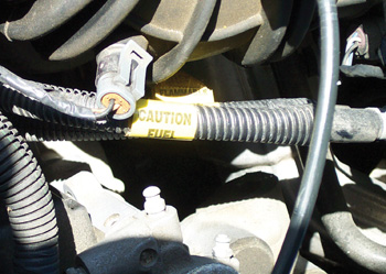 If fuel pressure is less than specifications, the problem might be an  obstructed or leaking fuel line.