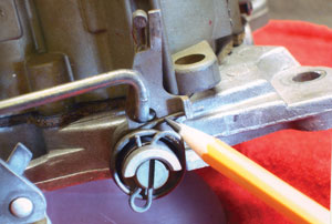 photo 6: metering rod travel can be easily checked by inserting an applicable tool into the front float bowl vent.